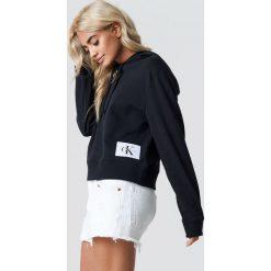 Calvin Klein Bluza z kapturem Harrisom True Icon - Black. Czarne bluzy rozpinane damskie Calvin Klein, z aplikacjami, z dzianiny, z kapturem. Za 404,95 zł.