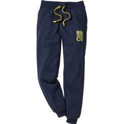 Spodnie dresowe Slim Fit bonprix ciemnoniebieski. Niebieskie rurki męskie marki Geographical Norway, z aplikacjami, z dresówki. Za 74,99 zł.