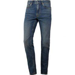 J.LINDEBERG DAMIEN DUST Jeans Skinny Fit mid blue. Niebieskie rurki męskie J.LINDEBERG, z bawełny. Za 569,00 zł.