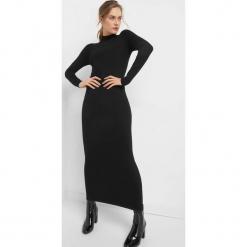 Dopasowana sukienka maxi. Czarne długie sukienki marki Orsay, l, z dzianiny, z golfem, dopasowane. W wyprzedaży za 80,00 zł.