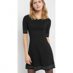 Dzianinowa sukienka. Brązowe sukienki dzianinowe marki Orsay, s. Za 99,99 zł.