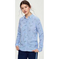 Wzorzysta koszula - Niebieski. Czerwone koszule damskie marki Sinsay, l, z nadrukiem. Za 39,99 zł.