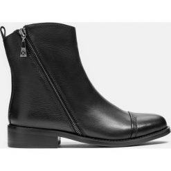 Czarne kozaki damskie. Czarne buty zimowe damskie marki Kazar, ze skóry, na wysokim obcasie. Za 599,00 zł.