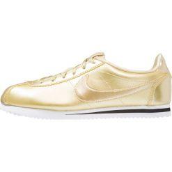Nike Sportswear CORTEZ SE  Tenisówki i Trampki metallic gold star. Żółte trampki chłopięce marki Nike Sportswear, z materiału. W wyprzedaży za 263,20 zł.