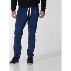 Spodnie męskie: Adidas Spodnie męskie Slim Sweatpants granatowy r. XS (M69898)