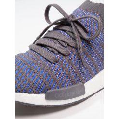 Adidas Originals NMD_R1 Tenisówki i Trampki hires blue/core black/chalk coral. Niebieskie tenisówki damskie marki adidas Originals, z materiału. W wyprzedaży za 411,95 zł.