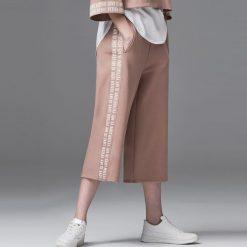 Spodnie dresowe damskie: Dresowe spodnie culotte – Kremowy