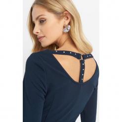 Dopasowana sukienka z dzianiny. Niebieskie sukienki dzianinowe marki Orsay, na co dzień, wizytowe, z okrągłym kołnierzem, dopasowane. Za 79,99 zł.