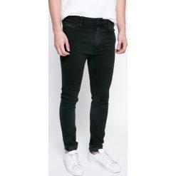 Calvin Klein Jeans - Jeansy. Czarne jeansy męskie skinny marki Calvin Klein Jeans, z aplikacjami, z bawełny. W wyprzedaży za 359,90 zł.