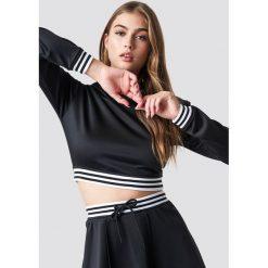 Pamela x NA-KD Krótka bluza sportowa - Black. Czerwone bluzy sportowe damskie marki KALENJI, z elastanu, z krótkim rękawem, krótkie. Za 161,95 zł.
