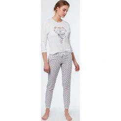 Etam - Spodnie piżamowe Izilda. Niebieskie piżamy damskie marki Etam, l, z bawełny. W wyprzedaży za 69,90 zł.