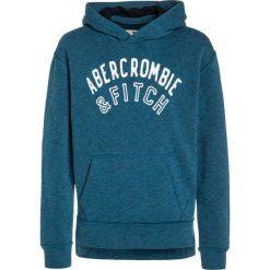 Abercrombie & Fitch CORE Bluza z kapturem blue. Niebieskie bejsbolówki męskie Abercrombie & Fitch, z bawełny, z kapturem. W wyprzedaży za 143,20 zł.