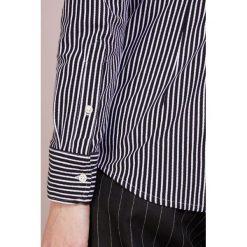 Polo Ralph Lauren HEIDI Koszula black/white. Czarne koszulki polo damskie marki Polo Ralph Lauren, l, z bawełny, polo. Za 509,00 zł.