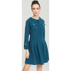 Ciemnoniebieska Sukienka Beauty Layla. Niebieskie sukienki mini other, uniwersalny. Za 89,99 zł.