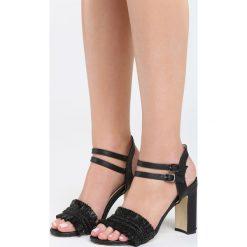 Czarne Sandały Eucalyptus. Czarne sandały damskie na słupku marki Born2be, z materiału, na wysokim obcasie. Za 79,99 zł.