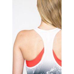 Under Armour - Top. Szare topy sportowe damskie marki Under Armour, m, z elastanu, z okrągłym kołnierzem. W wyprzedaży za 129,90 zł.