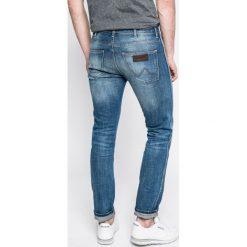 Wrangler - Jeansy Spencer. Niebieskie jeansy męskie slim Wrangler, z bawełny. W wyprzedaży za 249,90 zł.