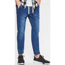 Jeansy SLIM JOGGER - Granatowy. Niebieskie jeansy męskie slim marki Cropp. Za 129,99 zł.