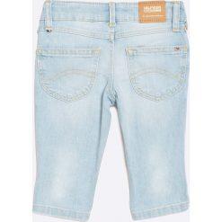 Tommy Hilfiger - Jeansy dziecięce 98-164 cm. Niebieskie jeansy dziewczęce TOMMY HILFIGER, z bawełny. W wyprzedaży za 99,90 zł.