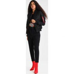 Spodnie dresowe damskie: ONLY ONLELLIE  Spodnie treningowe black