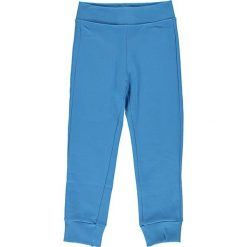 Spodnie dresowe w kolorze niebieskim. Niebieskie dresy chłopięce Benetton, z bawełny. W wyprzedaży za 22,95 zł.