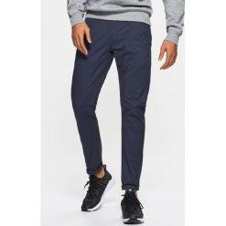 Chinosy męskie: Materiałowe spodnie typu chino – Granatowy