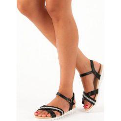 Czarne sandały płaskie TOP SHOES czarne. Czarne rzymianki damskie TOP SHOES, na płaskiej podeszwie. Za 59,90 zł.