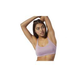Biustonosze Reebok Sport  Biustonosz Workout Ready. Fioletowe biustonosze sportowe marki other. Za 99,95 zł.