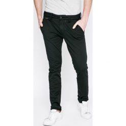 Guess Jeans - Spodnie Daniel. Niebieskie jeansy męskie skinny marki House, z jeansu. W wyprzedaży za 259,90 zł.
