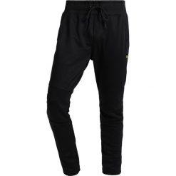 GStar MOTAC DC SUPER SLIM Spodnie treningowe black. Czarne rurki męskie marki G-Star, z bawełny. W wyprzedaży za 377,10 zł.