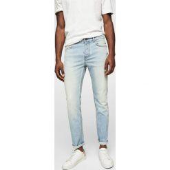 Mango Man - Jeansy Tim2. Niebieskie jeansy męskie slim marki Mango Man, z bawełny. W wyprzedaży za 99,90 zł.