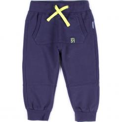 Spodnie. Niebieskie spodnie chłopięce SPACE, z bawełny. Za 29,90 zł.
