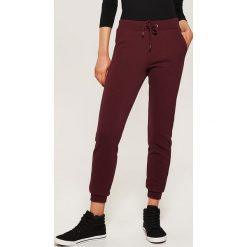 Spodnie dresowe damskie: Dresowe JOGGERY - Bordowy
