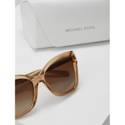 Michael Kors BARBADOS Okulary przeciwsłoneczne light brown crystal injected. Brązowe okulary przeciwsłoneczne damskie lenonki marki Michael Kors. Za 509,00 zł.
