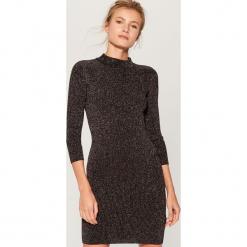 Sukienka z półgolfem - Czarny. Czarne sukienki z falbanami marki Mohito, l. Za 119,99 zł.