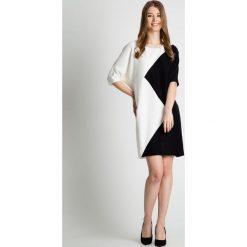 Czarno-biała sukienka z krótkim rękawem BIALCON. Czarne sukienki balowe marki bonprix, do pracy, w paski, moda ciążowa. Za 369,00 zł.