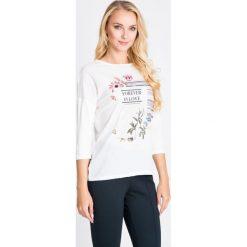 Bluzki damskie: Biała bluzka z napisem QUIOSQUE