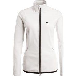 J.LINDEBERG TANAGA TECH Kurtka z polaru white. Białe kurtki sportowe damskie J.LINDEBERG, xs, z elastanu. W wyprzedaży za 566,10 zł.
