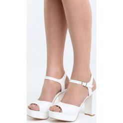 Białe Sandały Stained. Białe sandały damskie na słupku marki Born2be, z materiału, na wysokim obcasie. Za 44,99 zł.