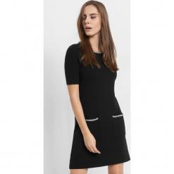 Trapezowa sukienka z kieszeniami. Brązowe sukienki dzianinowe marki Orsay, s. Za 119,99 zł.
