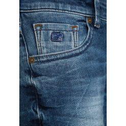 Scotch Shrunk STRUMMER  Jeansy Slim Fit meeting point. Niebieskie jeansy męskie relaxed fit Scotch Shrunk, z bawełny. Za 259,00 zł.