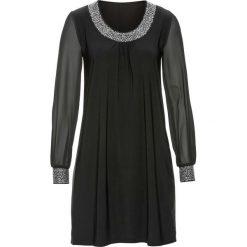 Sukienka z aplikacją ze sztrasów bonprix czarny. Czarne sukienki balowe marki bonprix, z aplikacjami, z dżerseju, z okrągłym kołnierzem. Za 129,99 zł.