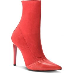Botki CARINII - B4447 H54-000-000-A49. Czarne buty zimowe damskie marki Carinii, z materiału, z okrągłym noskiem, na obcasie. W wyprzedaży za 279,00 zł.