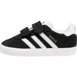 Adidas Originals GAZELLE Tenisówki i Trampki core black/footwear white. Czarne trampki chłopięce marki adidas Originals, z materiału. Za 229,00 zł.
