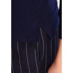Polo Ralph Lauren SLIM FIT Koszulka polo cruise navy. Szare topy sportowe damskie marki Polo Ralph Lauren, z bawełny. W wyprzedaży za 359,25 zł.