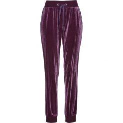 Spodnie dresowe aksamitne bonprix czarny bez. Fioletowe spodnie dresowe damskie marki DOMYOS, l, z bawełny. Za 89,99 zł.