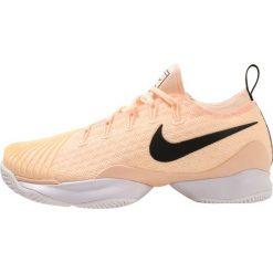 Nike Performance AIR ZOOM ULTRA REACT HC Obuwie multicourt salmon. Czerwone buty sportowe damskie Nike Performance, z materiału, na golfa. W wyprzedaży za 408,85 zł.