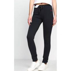 Spodnie dresowe damskie: Grafitowe Spodnie Dresowe Conformity