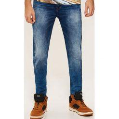 Jeansy slim - Niebieski. Niebieskie jeansy męskie slim House. Za 139,99 zł.