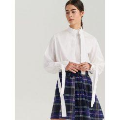 Biała koszula oversize ReDesign - Kremowy. Białe koszule damskie marki Reserved, l, z dzianiny. Za 199,99 zł.